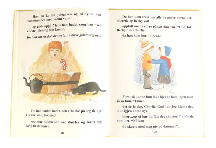 Åpen barnebok om Charlie skorteinsfeier. Bilde.