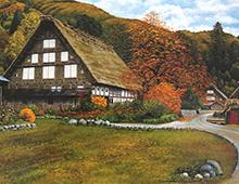Motiv av landsbyhus i høstlandskap. Bilde.