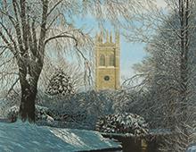 Puslespill med motiv av Magdalen College i Oxford i vinterlandskap. Bilde.