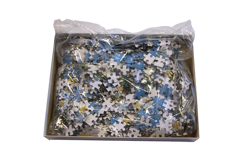 Puslespill 1000 biter vist innpakket i plast.