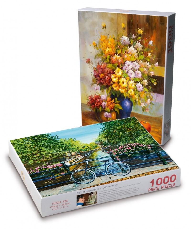 1000 biters puslespill. Viser Flowers and apples i bakgrunnen og Cycling by the canall foran. Bilde.