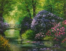 Kort med motiv av en elv med grønne trær og frodige, blomsterfylte busker langs bredden. En gammel bro går over elven. Bilde.