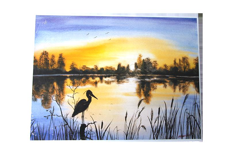 Puslespill med motiv av stille sjø med fugl. Bilde.