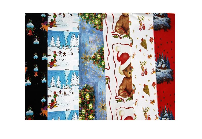 Viser 6 forskjellige motiv av julegavepapir. Bamser, engler, juletrepynt, juletre, hytte i skogen.