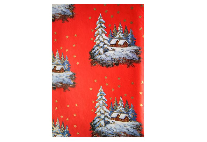 Julepapir med bilde av hytte i skogen. Bilde.